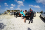 Divers on the beach